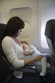 toddler asleep on plane